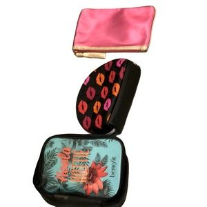 Three Makeup bags from brands buxom and benefit